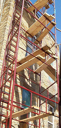 quickfit scaffold scaffolding against a wall
